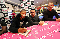 """Pictured L-R: Ashley Williams, Leon Britton and Lee Trundle Wednesday 14 January 2015<br /> Re: Swansea City footballers have signed copies of the """"Jack To A King """" dvd at HMV store in the Quadrant, Swansea, south Wales."""