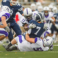 8 October 2016: Amherst College Purple & White Defensive Lineman Niyi Odewade, a Senior from Newark, NJ, sacks Middlebury College Panther Quarterback Jared Lebowitz, a Junior from Burlington, VT, at Alumni Stadium in Middlebury, Vermont. The Panthers edged out the Purple & While 27-26. Mandatory Credit: Ed Wolfstein Photo *** RAW (NEF) Image File Available ***