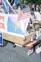 """A float is decorated with """"Straight Pride"""" flags and signs reading """"Great To Be Straight"""" with the white power OK hand symbol before the Straight Pride Parade in Boston, Massachusetts, on Sat., August 31, 2019. The parade was organized in reaction to LGBTQ Pride month activities by an organization called Super Happy Fun America."""