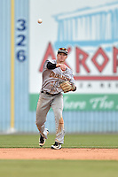 Charleston RiverDogs shortstop Kyle Holder (4) throws to first during game one of a double header against the Asheville Tourists at McCormick Field on July 8, 2016 in Asheville, North Carolina. The RiverDogs defeated the Tourists 10-4 in game one. (Tony Farlow/Four Seam Images)