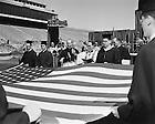 GPHR 45/1660:  Commencement - University President Rev. John J. Cavanaugh blessing the American flag, 1952/0601.  Image from the University of Notre Dame Archives.