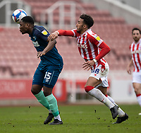 20th March 2021; Bet365 Stadium, Stoke, Staffordshire, England; English Football League Championship Football, Stoke City versus Derby County; Teden Mengi of Derby County clears as he heads the ball away