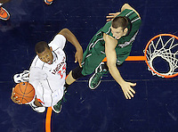 CHARLOTTESVILLE, VA- NOVEMBER 26:  Akil Mitchell #25 of the Virginia Cavaliers grabs a rebound in front of Alec Brown #21 of the Green Bay Phoenix during the game on November 26, 2011 at the John Paul Jones Arena in Charlottesville, Virginia. Virginia defeated Green Bay 68-42. (Photo by Andrew Shurtleff/Getty Images) *** Local Caption *** Alec Brown;Akil Mitchell