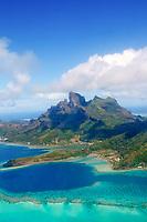 Aerial view of Bora Bora island, its turquoise lagoon, and Mount Otemanu, on a beautiful tropical island near Tahiti, French Polynesia, Pacific Ocean