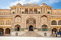 Jaipur, Rajasthan, India. Ganesh Pol, the Entrance to the Maharaja's Private Quarters, Amber (or Amer) Palace, near Jaipur.  The Hindu god Ganesh is above the door.