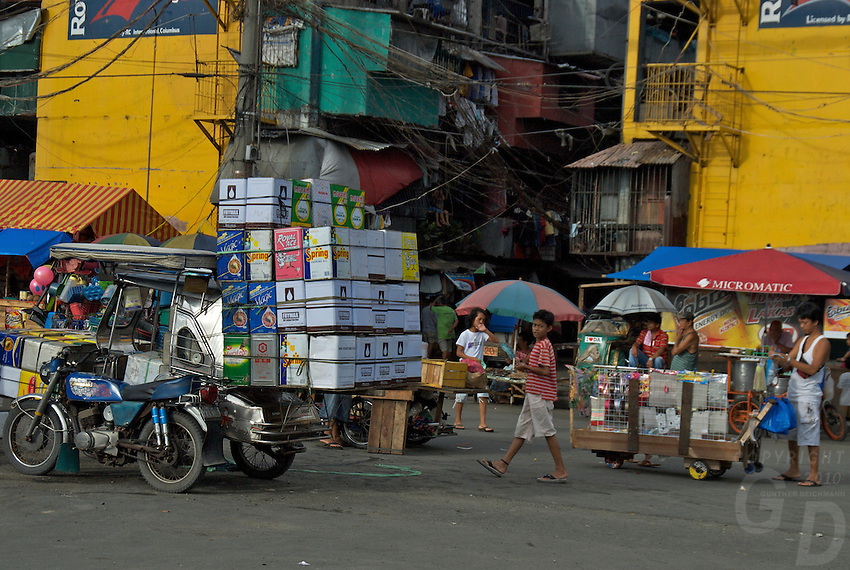 Recycling of used Containers from the car window Manila, Philippines