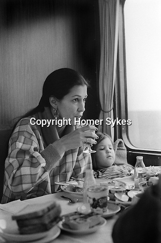 Rita Coolidge and daughter Casey 1978 having breakfast on a train travelling from West Berlin through East Germany to West where she and her husband Kris Kristofferson were giving a series of concerts. Other at the breakfast were staff travelling with her and Casey.