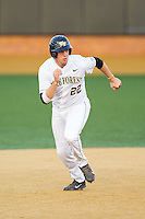 Will Craig (22) of the Wake Forest Demon Deacons takes off for third base during the game against the High Point Panthers at Wake Forest Baseball Park on April 2, 2014 in Winston-Salem, North Carolina.  The Demon Deacons defeated the Panthers 10-6.  (Brian Westerholt/Four Seam Images)