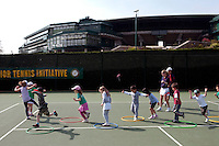 Children train during a coaching session with Dan Bloxham (not pictured) as part of the Junior Tennis initiative at Wimbledon, The All England Lawn Tennis Club (AELTC), London.
