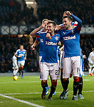 Jason Holt celebrates his goal for Rangers as he points to his head