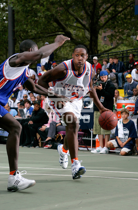 Corey Stokes (24) dribbles past a defender during the Elite 24 Hoops Classic game on September 1, 2006 held at Rucker Park in New York, New York.  The game brought together the top 24 high school basketball players in the country regardless of class or sneaker affiliation.