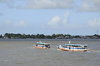 Typical passenger boats seen on Suriname River for carrying tourists to dolphin tour during the end of year 2010 party of fishermen at Leonsberg, located northern part of Paramaribo. ....End of year 2010 celebrations on the streets of Paramaribo. Suriname is one of biggest consumer in South America that using firecrackers, fireworks ( also locally known as pagara ) for celebrations, especially for end of every years and also beginning of every new Chinese Years.