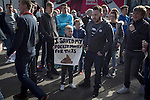 Newcastle United 1 Tottenham Hotspur 3 19/04/2015. St James Park, Premier League. A young protestor holding a sign during a demonstration at the Gallowgate end of the stadium before Newcastle United host Tottenham Hotspurs in an English Premier League match at St. James' Park. The match was boycotted by a section of the home support critical of the role of owner Mike Ashley and sponsorship by a payday loan company. The match was won by Spurs by 3-1, watched by 47,427, the lowest league gate of the season at the stadium. Photo by Colin McPherson.