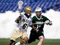 Nikk Davis (6) of Navy tries to work past Michael Crimmins (13) of Loyola at the Navy-Marine Corp Memorial Stadium in Annapolis, Maryland.   Loyola defeated Navy, 8-7, in overtime.