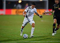 LAKE BUENA VISTA, FL - JULY 18: Cristian Pavón #10 of LA Galaxy shoots the ball during a game between Los Angeles Galaxy and Los Angeles FC at ESPN Wide World of Sports on July 18, 2020 in Lake Buena Vista, Florida.