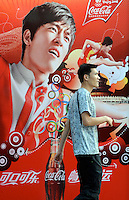 A Coca-cola advert featuring Chinese 110 meters hurdler Liu Xiang on an advertising hoarding outside Chaoyang Park, where the beach volley is being played. After years of hype and multi-million dollar endorsements Liu Xiang disappointed the whole of China and failed before the first hurdle and is out of the games with injury..