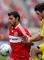 Chicago Fire midfielder Peter Lowry (29) is pressured by Columbus Crew midfielder Danny O'Rourke (5).  The Columbus Crew tied the Chicago Fire 2-2 at Toyota Park in Bridgeview, IL on September 20, 2009.