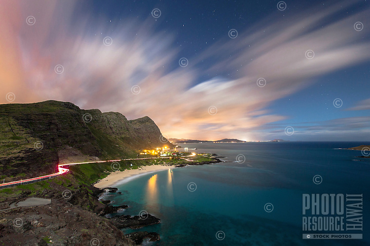 View of Makapu'u Beach, the Ko'olau mountains and the Windward O'ahu coastline at night, with Waimanalo, in distance, O'ahu.