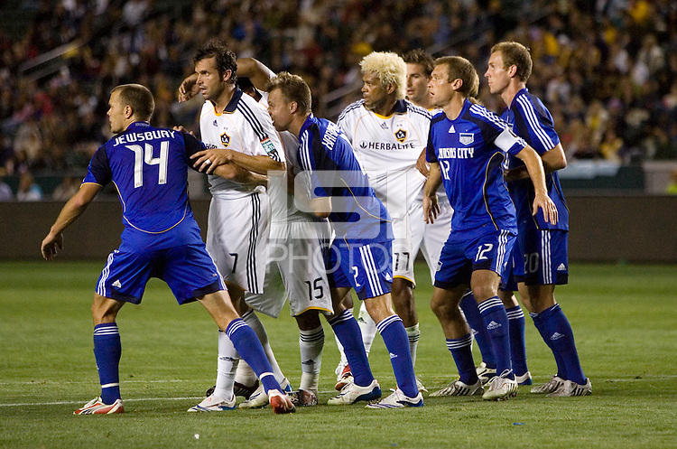 The Galaxy and Wizards push and shove trying to position themselves for a cornerkick during the second half of a MLS match. The LA Galaxy defeated the Kansas City Wizards 3-1 at Home Depot Center stadium in Carson, Calif., on Saturday, May 24, 2008.