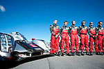 Timo Bernhard (DEU) / Marcel Fa?ssler (CHE) / Romain Dumas (FRA), #1 Audi Sport Team Joest Audi R18 chassis, LMP1 category engineers stand with the car on the gird before the 14th annual Petit Le Mans.