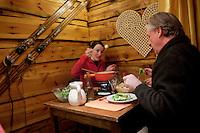Diners eat fondue savoyarde at the restaurant l'Auberge d'Oul, Bonneval sur Arc, Savoie, France, 16 February 2012.