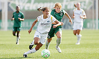Stephanie Cox (#4 white) pursued by Lori Chalupny...Saint Louis Athletica and LA Sol played to a 0-0 tie at Robert Herman Stadium, St Louis, MO.