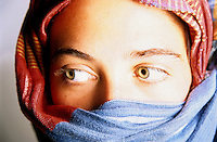 Portrait of a young woman wearing a traditional headscarf.