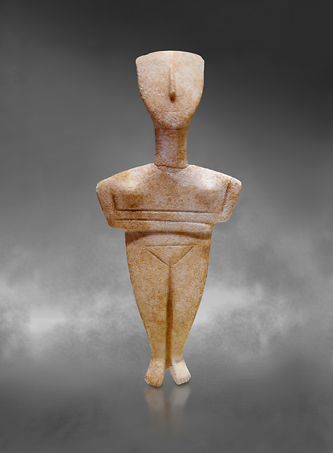 Cyclades spedos type stone statue figurine with folded arms, Archanes Phourni, 2300-1700 BC. Heraklion Archaeological Museum, grey background.<br /> <br /> These voitive atatues were buried with the dead all over the Ctcladic Islands of Greece