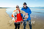 Tracy and Michael O'Flaherty with Mimi and Bonny the dogs enjoying a stroll on Banna beach on Saturday.