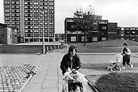 England. Greater Manchester. Salford. Women living in poverty. Two mothers push a stroller with their young children. Salford is a city in the Metropolitan Borough of Salford in Greater Manchester. North West England is one of nine official regions of England. © 1990 Didier Ruef