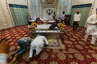 Asia,India,Punjab, Amristar, Golden temple,Palki Sahib where is the Sikh holy book, pilgrims pray at the sacre tombs