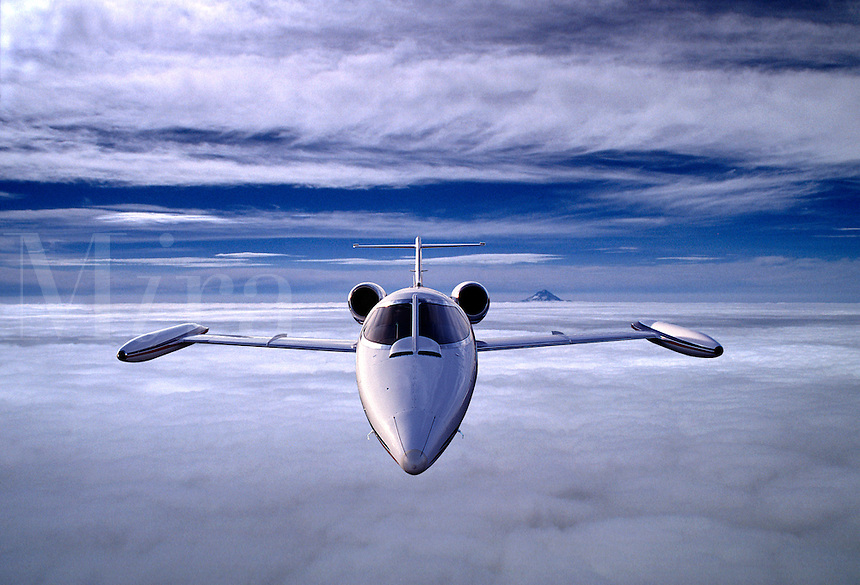 Lear Jet 35 over clouds. Digital composite.