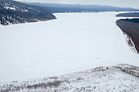 Aerial of dog teams on the Yukon River between Grayling and Eagle Island during Iditarod 2009