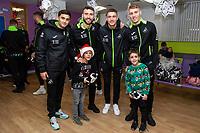 Pictured: (L-R) Yan Dhanda, Borja Baston, Kristoffer Peterson, Jay Fulton of Swansea City at Morriston Hospital, Swansea, Wales, UK. Thursday 19 December 2019