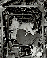 Heavier work than ever before is now being allotted women; besides many highly technical jobs. Jacqueline Bourdon and Elizabeth Saad work inside a bomber<br /> <br /> PHOTO :    - Toronto Star Archives - AQP