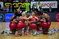 The Roses huddle before the Cadbury Netball Series Taini Jamison Trophy match between New Zealand Silver Ferns and England Roses at Claudelands Arena in Hamilton, New Zealand on Wednesday, 28 October 2020. Photo: Dave Lintott / lintottphoto.co.nz