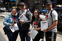 NEW YORK , NY JUNE 16: Visitors from Puerto Rico pose after they received the results at Free Covid test site in Times Square as the city mark the end of the COVID-19 restrictions in  New York on June 17 2021. <br /> (Photo by Kena Betancur/VIEWpress)