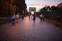 Tourists make their way towards the Arch of Titus at the edge of the Roman Forum on Tuesday, Sept. 22, 2015, in Rome, Italy. (Photo by James Brosher)