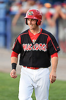 Batavia Muckdogs first baseman Eric Fisher (33) walks to the dugout after scoring a run during a game against the Auburn Doubledays on August 31, 2014 at Dwyer Stadium in Batavia, New York.  Batavia defeated Auburn 7-6.  (Mike Janes/Four Seam Images)