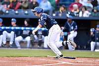 Asheville Tourists catcher Dom Nunez (9) swings at a pitch during a game against the Greenville Drive on April 16, 2015 in Asheville, North Carolina. The Tourists defeated the Drive 5-4. (Tony Farlow/Four Seam Images)