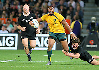 Australia's Sekope Kepu, left, in the tackle of New Zealand's Tawera Kerr-Barlow in the Bledisloe Cup rugby match, Forsyth Barr Stadium, Dunedin, New Zealand, Saturday, October 19, 2013. Credit:SNPA / Dianne Manson.