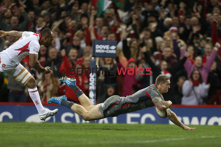 Wales center Owen Williams dives over to score the first try of the matchh.<br /> <br /> Dove Men Series 2013<br /> Wales v Tonga<br /> Millennium Stadium - Cardiff<br /> 22.11.13<br /> ©Steve Pope-SPORTINGWALES