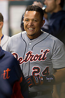 Detroit Tigers third baseman Miguel Cabrera (24) smiles in the Tigers dugout after scoring in the fourth inning of the MLB baseball game against the Houston Astros on May 3, 2013 at Minute Maid Park in Houston, Texas. Detroit defeated Houston 4-3. (Andrew Woolley/Four Seam Images).