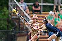NEWTON, MA - MAY 22: Caitlynn Mossman #7 of Boston College behind the net as Kathleen Roe #6 of Notre Dame defends during NCAA Division I Women's Lacrosse Tournament quarterfinal round game between Notre Dame and Boston College at Newton Campus Lacrosse Field on May 22, 2021 in Newton, Massachusetts.