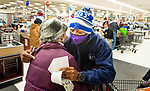 WATERBURY, CT-122220JS01- Kristopher Reese, Pastor at Grace Baptist Church in Waterbury gets a hug from customer Sally Riddick of Waterbury after Rev. Reece surprised her and paid for her groceries Tuesday at the ShopRite of Waterbury. <br /> Jim Shannon Republican-American