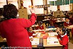 K-8 Parochial School Bronx New York Kindergarten female teacher talking to class about coins math class horizontal