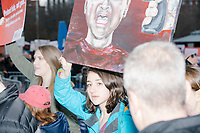 Students enter Boston Common after marching to the park from Roxby Crossing during the March For Our Lives protest and demonstration in Boston, Massachusetts, USA, on Sat., March 24, 2018. The march was held in response to recent school gun violence. Here, people hold a painting depicting a gun held to a child's head.