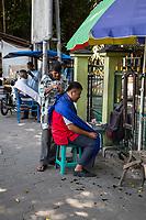 Yogyakarta, Java, Indonesia.  Sidewalk Barber Shop.