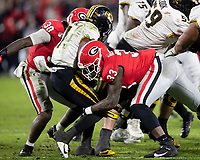 ATHENS, GA - NOVEMBER 09: Tyler Badie #1 of the Missouri Tigers is tackled by Robert Beal Jr. #33 and Tae Crowder #30 of the Georgia Bulldogs during a game between Missouri Tigers and Georgia Bulldogs at Sanford Stadium on November 09, 2019 in Athens, Georgia.