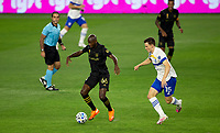 LOS ANGELES, CA - SEPTEMBER 02: Bradley Wright-Phillips #66 of LAFC moves with the ball past Tanner Beason #15 of San Jose Earthquakes during a game between San Jose Earthquakes and Los Angeles FC at Banc of California stadium on September 02, 2020 in Los Angeles, California.
